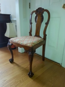The chair rebuilt, French polished and ready for use.