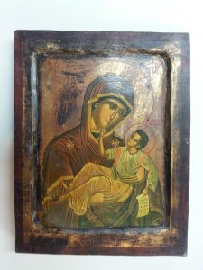 The icon after restoration with the gesso replaced and the lifting paint in-painted with gouache.