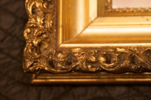 Antique frame after carving and gilding compound.